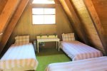 Loft area with three twin beds