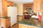 Large kitchen with oversized range and fridge
