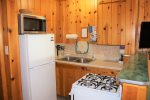 Kitchenette with fridge and four burner range/stove