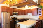 Enjoy making home cooked meals in this lovely kitchen.