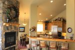 Kitchen area with wood fireplace and four counter seats