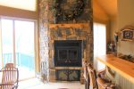 Wood burning fireplace in the kitchen and living area.