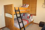 Bunk room with two bunk beds. Perfect for kids.