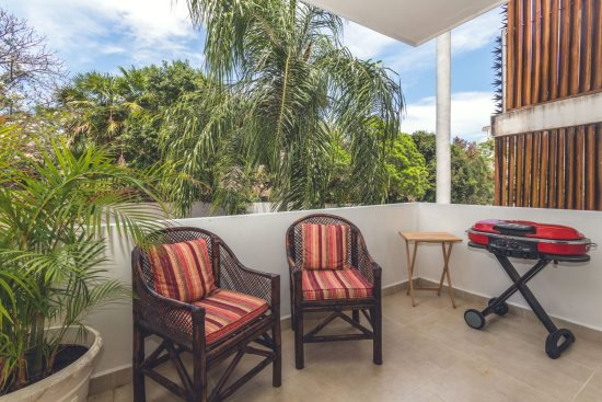 Patio with BBQ and nice breezes - great for people watching