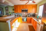 Cook`s kitchen with stainless steel appliances