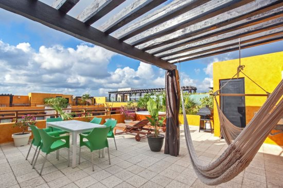 Your private rooftop terrace with hammocks, BBQ and Jacuzzi tub