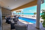 Your private beach front ocean view terrace with BBQ, pool and lounge chairs