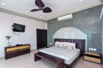 Master suite with ocean view, king bed, TV and en suite bathroom