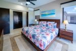 Master suite with king bed, ocean view and en suite bathroom