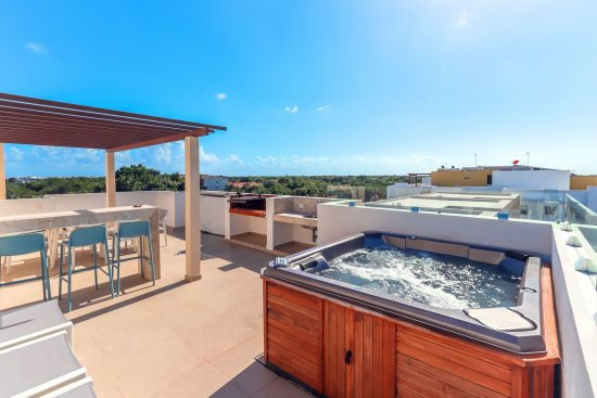 Your private rooftop terrace with Jacuzzi, BBQ, dining set and outdoor shower