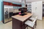 Full kitchen with stainless steel appliances
