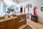 Kitchen with stainless steel appliances and breakfast bar