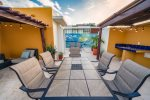 Your private roof deck with lounge chairs, patio table, BBQ, outdoor shower and pool view