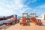 The Casa del Mar rooftop pool with beds, lounge chairs and ocean view