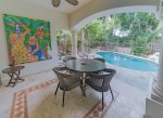 Dine alfresco on your patio with pool view