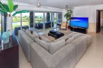 Ocean view living room with flat screen HDTV with satellite and DVD player