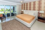 1st master suite with king bed, ocean view, HDTV with satellite and DVD player
