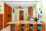 Kitchen with Breakfast Bar and Attached Laundry Room