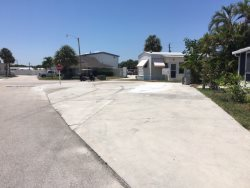 Large Corner  Near Private Beach Access Lot will hold up to 45ft + RV 4 Month Min. During Season