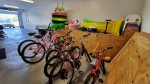 Garage stocked with 6 bikes, beach floats, and all kinds of beach toys