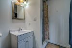 Lower level rec room with bar and ping pong
