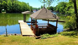 Welcome to the Sunshine Shack- Just listed and ready to go by Memorial Day weekend! Sleeps 8 and 1 furry friend