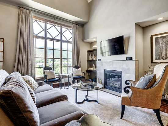 Spacious Living Room with Fireplace, Wall of Windows, Flat Screen TV, and Great Views.