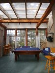 Pool Room- Flat Screen TV- Expansive custom windows- High Ceiling Wood Beams