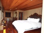 Downstairs Master Bedroom- King Bed- Koa Wood Floors- Redwood Ceilings/Walls