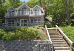 We named this manificant ocean front home QUAHOG BAY COTTAGE because it is nested hillside off  Quahog Bay. This 2 story vacation rental has 3 bedrooms & 2 bathrooms and can accommodate up to 6 guests.