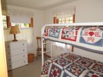 ...and finally, we have a bunk bed in our fourth bedroom, a fun spot for the kids with red white and blue decor.