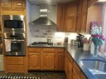 Here`s a second shot of the kitchen. Gourmet kitchen with stainless steel wall oven, microwave. gas jenn air cooktop, dishwasher too