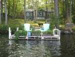 Here is what the house and dock look like from the swim float which is on a mooring about 20 feet out in the pond.