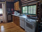 I love this area as it reminds me of a cabin kitchen you might see in the old west and adds to the overall cozy feeling of this special place As you see... you`ll have everything you need in the kitchen and then some.