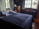 Our master bedroom provides a double bed and plenty of room to store your belongings. Everything in site is wood.