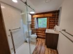 Third bedroom, or master, with windows let in the morning sun and spectacular Linekin Bay