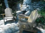 Adirondack Chairs and granite barbecue half way down the stairs, waterside