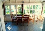 Enjoy al fresco dining and water views from the screened enclosed porch