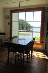 Kitchen table with windows to the water