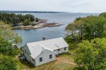 This aerial view of Merwick Cottage shows the magnificence of this waterfront property.