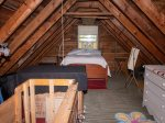 The upstairs is an open sleeping area with a Double bed and 2 Twin beds