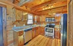 Kitchen is Equipped with Granite Countertops and Stainless Steel Appliances