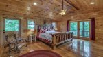 Upper Level Master Suite Features a King Size Bed