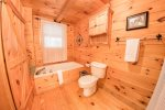 Main Level Bathroom Features a Stand Up Shower and Jetted Tub