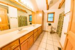 Maser Bathroom Features Double Vanity, Standard Tub/Shower, and Stand Up Shower