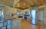 Kitchen Features Stainless Steel Appliances and Granite Counter Tops