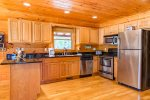 Fully Equipped Kitchen Features Granite Counter Tops and Stainless Steel Appliances