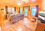 Main Level Bedroom Features a King Size Bed, Flat Screen Tv & Access to Covered Deck