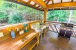 Deck Off Kitchen Features Gas Grill, Sitting Area, and Hottub