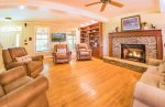 Spacious Living Room Features a Gas Fireplace and Flat Screen TV